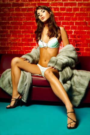 Sexy lingerie female model on red sofa Stock Photo - 500406