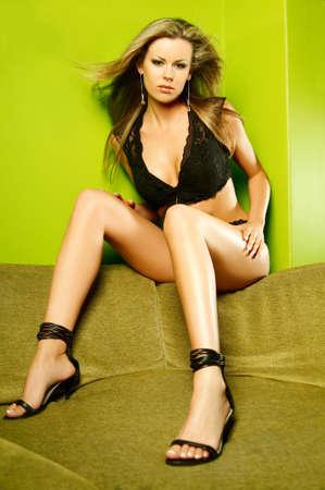 Sexy lingerie female model on sofa Stock Photo - 508563