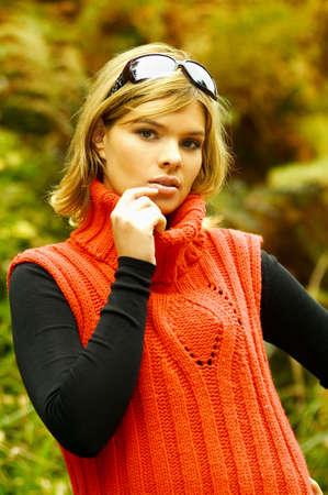 Beautiful woman portrait in autumn outdoors