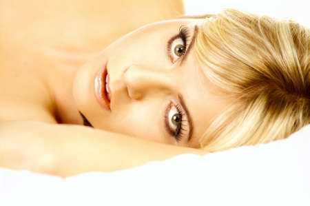 Portrait of attractive beautiful young woman on bed photo