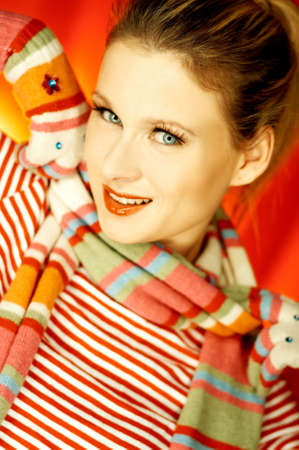 Portrait of attractive beautiful young woman wearing gloves and scarf photo