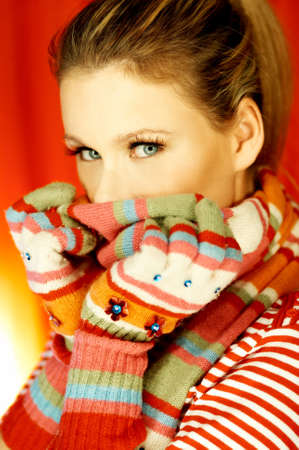 Portrait of attractive beautiful young woman wearing gloves and scarf Stock Photo - 603444