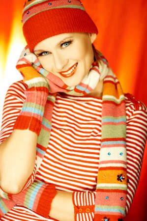Portrait of attractive beautiful young woman wearing gloves, cap and scarf photo