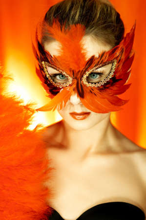 Portrait of attractive beautiful young woman wearing red carnival mask Stock Photo - 603511