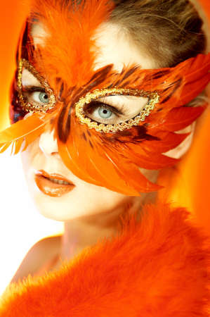 Portrait of attractive beautiful young woman wearing red carnival mask Stock Photo - 603512