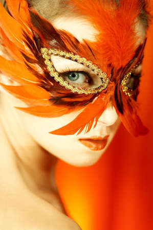 Portrait of attractive beautiful young woman wearing red carnival mask Stock Photo - 603510