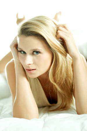 Portrait of attractive beautiful young woman on bed Stock Photo - 603144