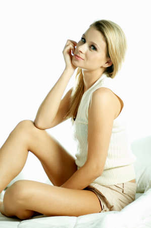 Portrait of attractive beautiful young woman on bed Stock Photo - 603146
