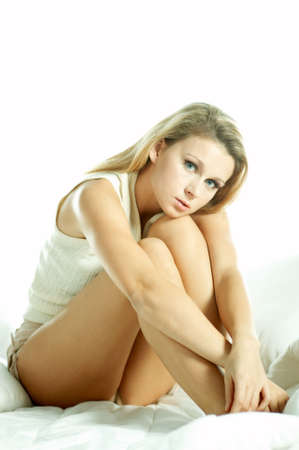 Portrait of attractive beautiful young woman on bed Stock Photo - 603147