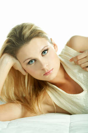 Portrait of attractive beautiful young woman on bed Stock Photo - 603148