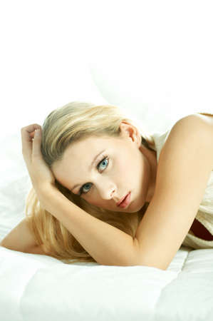 Portrait of attractive beautiful young woman on bed Stock Photo - 603149