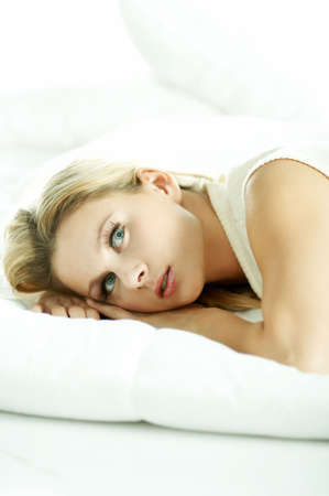 Portrait of attractive beautiful young woman on bed Stock Photo - 603150