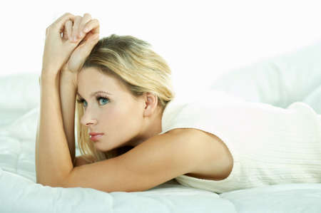 Portrait of attractive beautiful young woman on bed Stock Photo - 603502