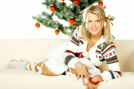 Beautiful young woman next to christmas tree on white background Stock Photo - 606505