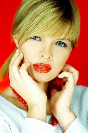 Portrait of attractive beautiful young sexy woman red necklace Stock Photo - 610695