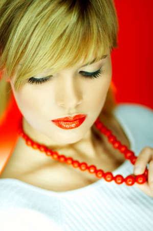 Portrait of attractive beautiful young sexy woman red necklace Stock Photo - 610653