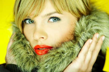 Portrait of beautiful woman wearing hooded winter jakcet Stock Photo - 610670