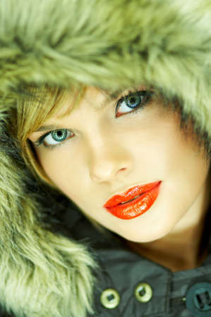 Portrait of beautiful woman wearing hooded winter jakcet Stock Photo - 610669