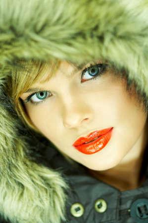 Portrait of beautiful woman wearing hooded winter jakcet Stock Photo - 610669