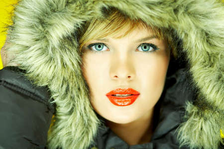 Portrait of beautiful woman wearing hooded winter jakcet photo