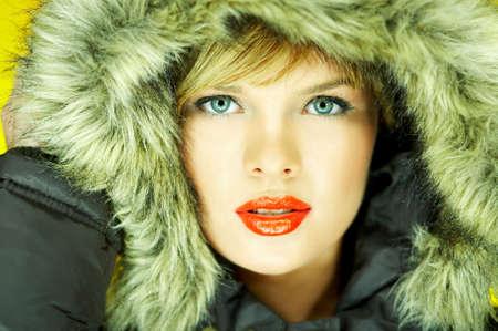Portrait of beautiful woman wearing hooded winter jakcet Stock Photo - 610668