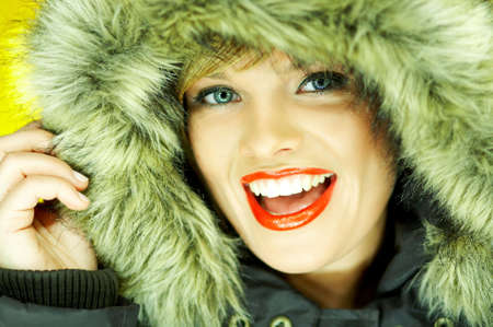 Portrait of beautiful woman wearing hooded winter jakcet Stock Photo - 610667