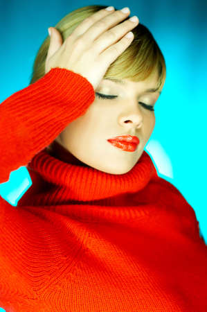 Portrait of beautiful woman wearing red sweater Stock Photo - 610663