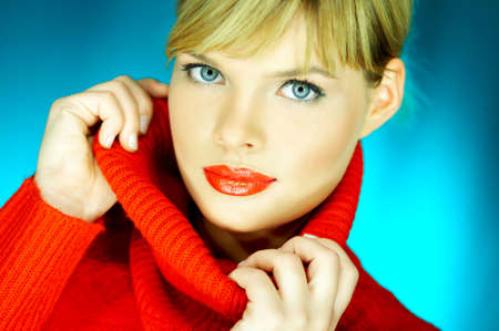 Portrait of beautiful woman wearing red sweater Stock Photo - 610661