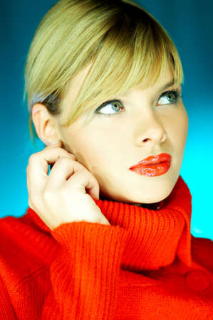 Portrait of beautiful woman wearing red sweater photo