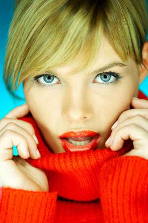 Portrait of beautiful woman wearing red sweater Stock Photo - 610660