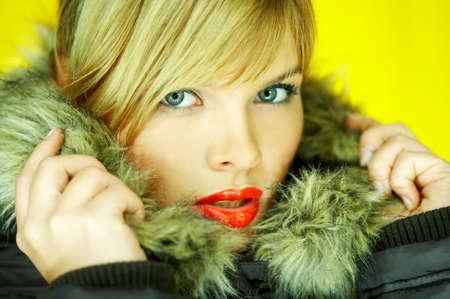 Portrait of beautiful woman wearing hooded winter jakcet Stock Photo - 613996