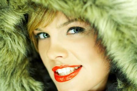 Portrait of beautiful woman wearing hooded winter jakcet Stock Photo - 613997
