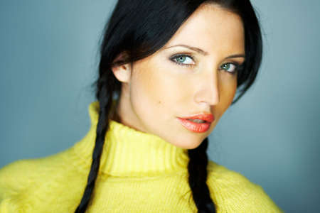gorgeus: Portrait of beautiful woman wearing yellow sweater