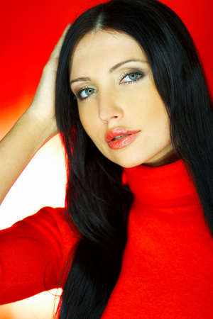 gorgeus: Portrait of beautiful woman wearing red sweater Stock Photo