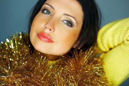 Portrait of beautiful woman wearing yellow sweater photo