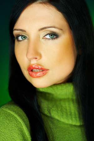 gorgeus: Portrait of beautiful woman wearing green sweater Stock Photo