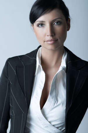 businesswear: Beautiful brunette business woman isolated on clear background