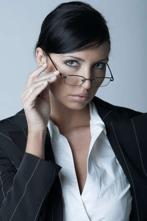 Beautiful brunette business woman with glasses isolated on clear background photo