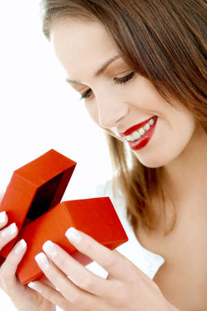 Portrait of Beautiful woman with red boxed gift Stock Photo - 705698