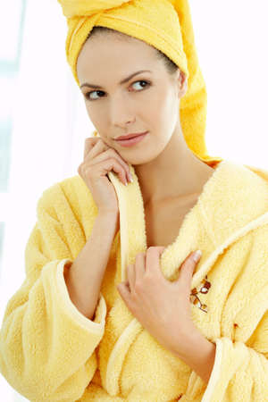 Portrait of Fresh and Beautiful brunette woman wearing white towel on her head photo