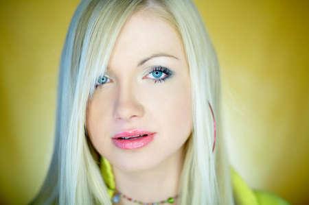Portrait of beautiful blond woman wearing yellow shirt Stock Photo - 734144