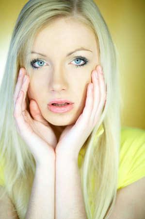 Portrait of beautiful blond woman wearing yellow shirt Stock Photo - 734092