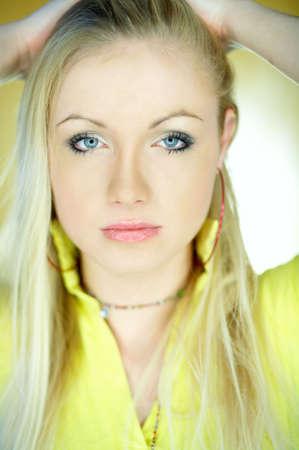 Portrait of beautiful blond woman wearing yellow shirt Stock Photo - 734093