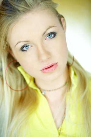 Portrait of beautiful blond woman wearing yellow shirt Stock Photo - 734094