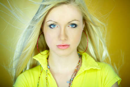 Portrait of beautiful blond woman wearing yellow shirt Stock Photo - 734096
