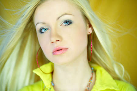 Portrait of beautiful blond woman wearing yellow shirt Stock Photo - 734097