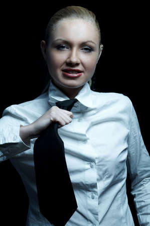 Beautiful business woman wearing black tie and white shirt isolated on black background Stock Photo - 739251