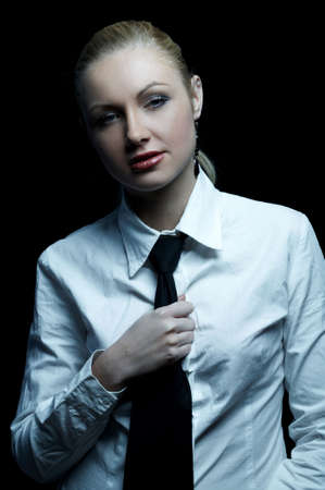 Beautiful business woman wearing black tie and white shirt isolated on black background Stock Photo - 739252