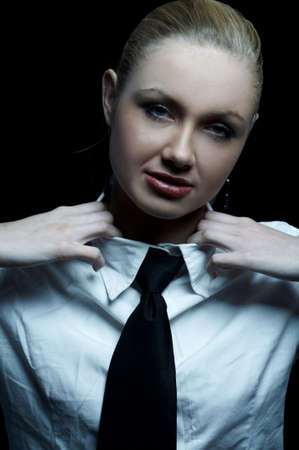 Beautiful business woman wearing black tie and white shirt isolated on black background Stock Photo - 739253