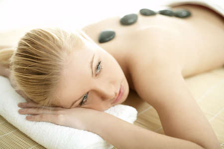 lastone: Young blond woman getting lastone treatment at spa